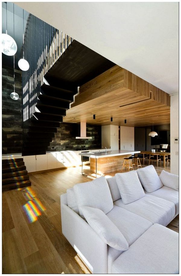 Modern-interior-with-a-high-ceiling-and-warm-wooden-surfaces