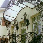Кованые козырьки (45 фото) — двускатные, арочные, вогнутые, круглые